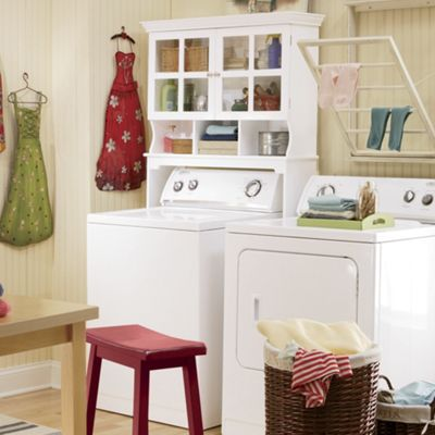 space saving laundry cabinet from through the country door 41698. Black Bedroom Furniture Sets. Home Design Ideas