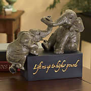 higher ground elephant figurine