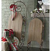 set of 2 old fashioned sleds