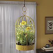 lit flower art bird cage