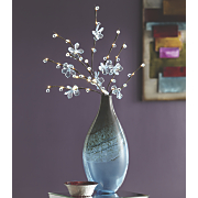 blue flower branches and glass vase