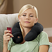 massaging neck pillow with speakers by conair