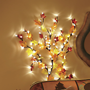 small lighted vine with trailing autumn leaves