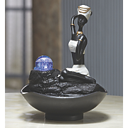 kneeling woman led fountain