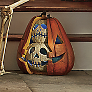 lighted split pumpkin with skulls