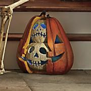 lighted split pumpkin with skulls