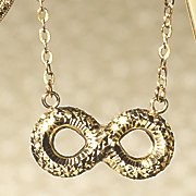 14k gold diamond cut infinity pendant