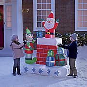 elf and santa chimney inflatable