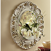 lighted floral arrangement with wooden frame