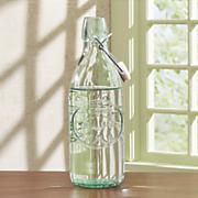 embossed green glass bottle