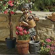 girl watering tulips fountain