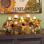 lighted sunflower centerpiece with votive holders