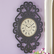 black scroll wall clock