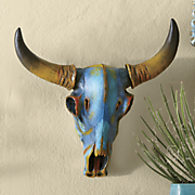 turquoise colored skull wall decor