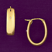 10k gold polished wide oval hoop earrings