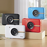 snap instant camera and extra paper by polaroid