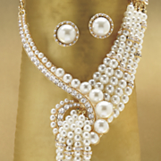 white faux pearl multistrand necklace and earring set