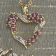 open heart ruby and diamond pendant