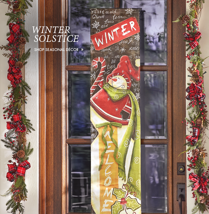 Winter Solstice scene, with Burlap Snowman Banner and garland decorating a wood and glass front door