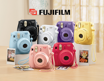 Seven Instax Mini 8 Cameras in a variety of colors by Fujifilm
