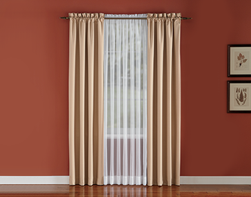 Living room window hung with Color Connection Pinch Pleat Panel Pairs by Montgomery Ward