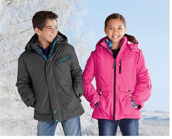 Boy and girl, both wearing the 2-layer System Jacket, an item in our Kid's clothing section