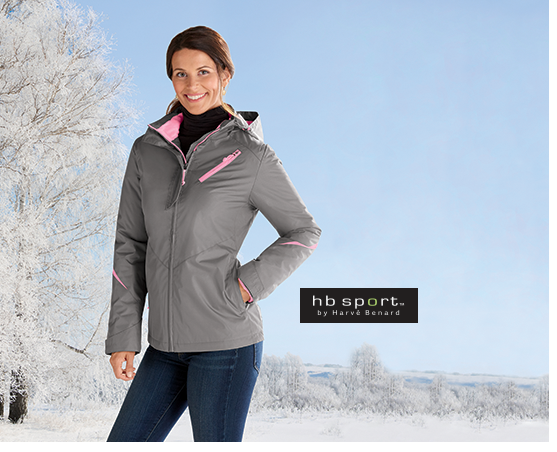 Woman standing outside in snow-covered countryside, wearing Hooded Active Jacket, HB Sport by Harvé Bernard