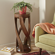 twisted hand carved plant stand