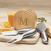 personalized cheese block with 3 metal utensils