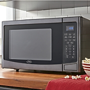 1.2 Cubic Foot Microwave by Ginny's