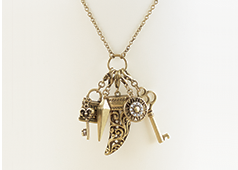 Necklaces category, picturing our Long Pendant with Horn and Charms